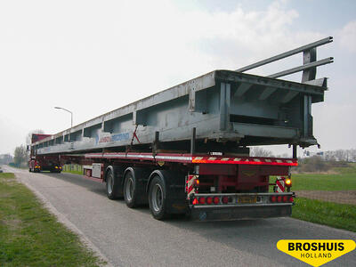 Triple extendable platform trailer with load